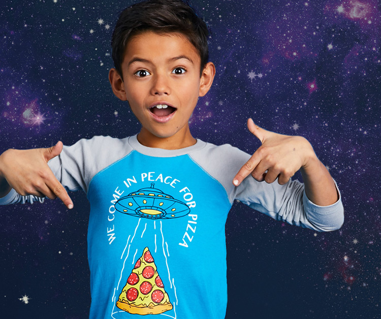 Photo of a boy in outer space wearing a cool graphic tee