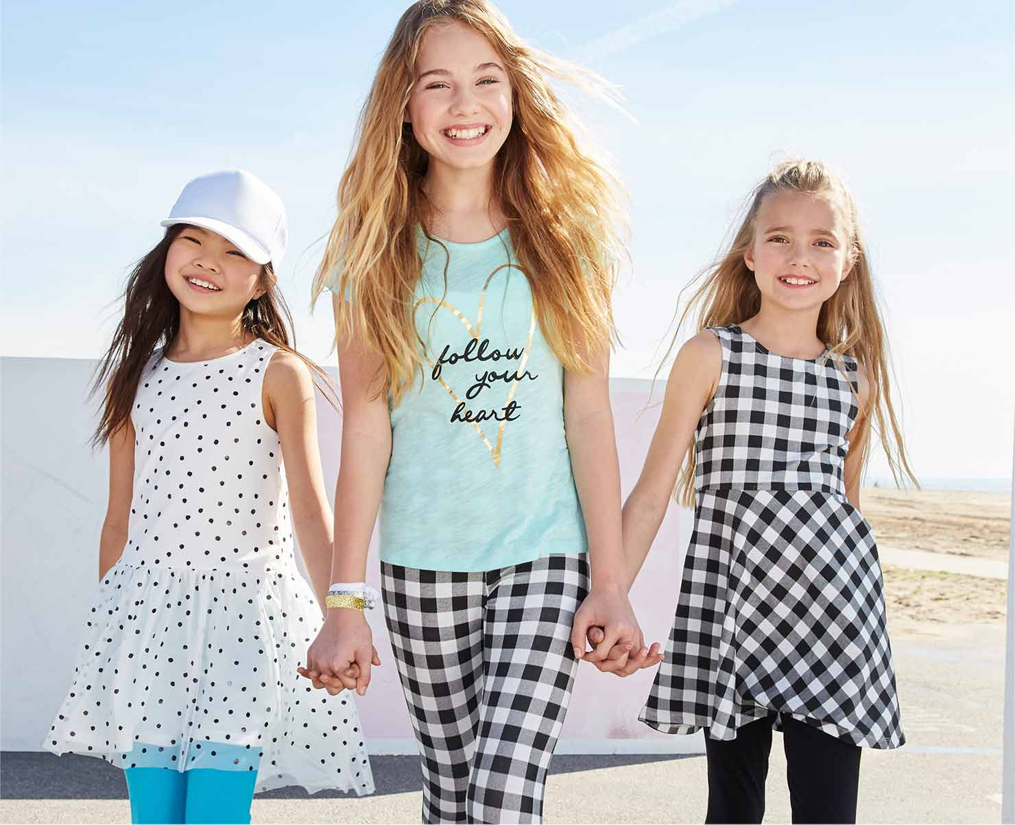 Photo of girls walking in cute kids clothes