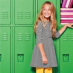Girl standing by her locker
