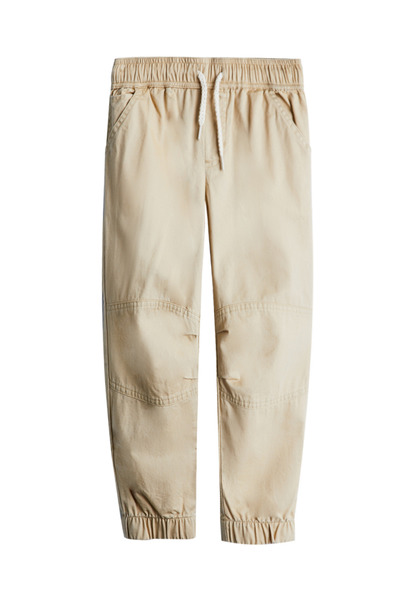 FabKids Jeans & Pants Woven Pieced Jogger Boys Beige Size XXS Comfy and stylish woven pant with side pockets, elastic waistband and cuffed pant legs. Loose fit around hips and skinny at ankle.